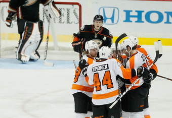 ANAHEIM, CA - DECEMBER 02:  (L-R) Claude Giroux #28, Kimmo Timonen #44 and Jaromir Jagr #68 of the Philadelphia Flyers celebrate Jagr's third period goal against the Anaheim Ducks at Honda Center on December 2, 2011 in Anaheim, California. The Flyers defe