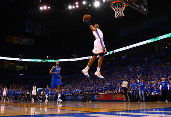 OKLAHOMA CITY, OK - MAY 23:  Russell Westbrook #0 of the Oklahoma City Thunder goes up for a dunk in the first quarter while taking on the Dallas Mavericks in Game Four of the Western Conference Finals during the 2011 NBA Playoffs at Oklahoma City Arena o