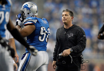 DETROIT, MI - NOVEMBER 24:  Head coach Jim Schwartz looks at defensive end Ndamukong Suh #90 of the Detroit Lions after Suh is ejected from the game for unsportsmanlike conduct in the third quarter against the Green Bay Packers during the Thanksgiving Day