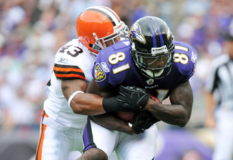 BALTIMORE - SEPTEMBER 26:  Anquan Boldin #81 of the Baltimore Ravens makes a catch against T.J Ward #43 of the Cleveland Browns  at M&T Bank Stadium on September 26, 2010 in Baltimore, Maryland. The Ravens defeated the Browns 24-17. (Photo by Larry French