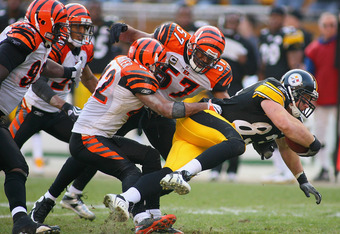 PITTSBURGH - NOVEMBER 15: Heath Miller #83 of the Pittsburgh Steelers tries to escape the tackle of Chris Crocker #42 and Dhani Jones #57 of  the Cincinnati Bengals  at Heinz Field on November 15, 2009 in Pittsburgh, Pennsylvania. The Bengals won 18-12.