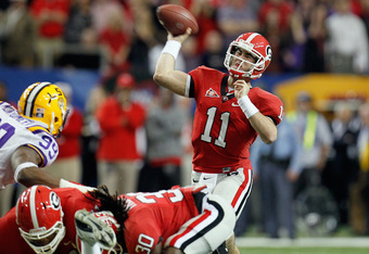 ATLANTA, GA - DECEMBER 03:  Quarterback Aaron Murray #11 of the Georgia Bulldogs throws a pass in the first quarter against the LSU Tigers during the 2011 SEC Conference Championship at  Georgia Dome on December 3, 2011 in Atlanta, Georgia.  (Photo by Kev
