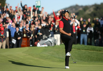 Woods celebrates his winning birdie-putt.