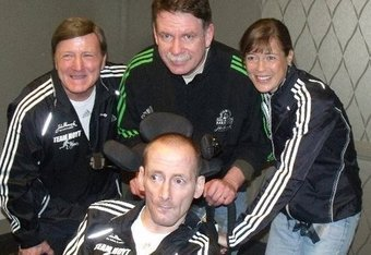 Dick Hoyt (left) Jim Boyle, President of John Hancock (back), Uta Pippig (right) and Rick Hoyt (front) at last years Team Hoyt pasta dinner