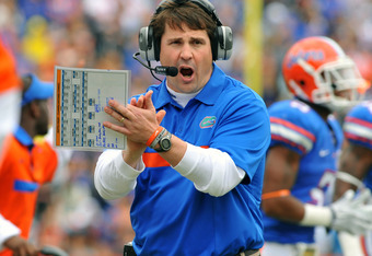 GAINESVILLE, FL -  NOVEMBER 5:  Coach Will Muschamp of the Florida Gators cheers play against the Vanderbilt Commodores November 5, 2011 at Ben Hill Griffin Stadium in Gainesville, Florida.  (Photo by Al Messerschmidt/Getty Images)