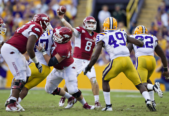 BATON ROUGE, LA - NOVEMBER 25:   Quarterback Tyler Wilson #8 of the Arkansas Razorbacks throws a pass against the LSU Tigers at Tiger Stadium on November 25, 2011 in Baton Rouge, Louisiana.  The Tigers defeated the Razorbacks 41 to 17.  (Photo by Wesley H