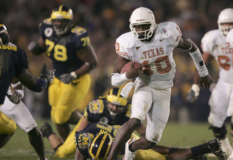 PASADENA, CA - JANUARY 01:  Quarterback Vince Young #10 of the Texas Longhorns runs with the ball against the Michigan Wolverines in the 91st Rose Bowl Game at the Rose Bowl on January 1, 2005 in Pasadena, California.   Texas defeated Michigan 38-37.  (Ph