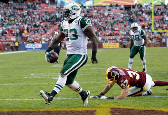LANDOVER, MD - DECEMBER 04:  Shonn Greene #23 of the New York Jets scores a touchdown in front of  Reed Doughty #37 of the Washington Redskins  during the second half at FedExField on December 4, 2011 in Landover, Maryland.  (Photo by Rob Carr/Getty Image