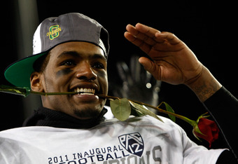EUGENE, OR - DECEMBER 02:  Darron Thomas #5 of the Oregon Ducks celebrates after defeating  the UCLA Bruins  49-31 during the Pac 12 Championship Game on December 2, 2011 at the Autzen Stadium in Eugene, Oregon.  (Photo by Jonathan Ferrey/Getty Images)