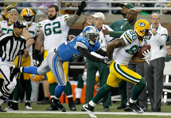 DETROIT, MI - NOVEMBER 24:  Tight end Jermichael Finley #88 of the Green Bay Packers runs past Amari Spievey #42 of the Detroit Lions in the second quarter during the Thanksgiving Day game at Ford Field on November 24, 2011 in Detroit, Michigan. The play