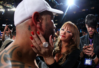 NEW YORK, NY - DECEMBER 03:  Miguel Cotto of Puerto Rico is greeted by his wife Melissa after defeating against Antonio Margarito of Mexico by TKO  in the tenth round during the WBA World Junior Middleweight Title fight at Madison Square Garden on Decembe