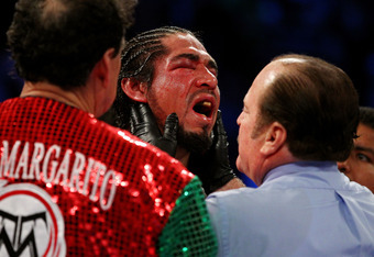 NEW YORK, NY - DECEMBER 03:  Antonio Margarito of Mexico reacts as referee Steve Smoger (R) examines his right eye against Miguel Cotto of Puerto Rico in the tenth round during the WBA World Junior Middleweight Title fight at Madison Square Garden on Dece