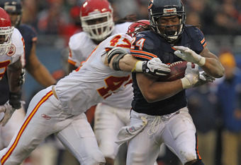 CHICAGO, IL - DECEMBER 04: Marion Barber #24 of the Chicago Bears shakes off a tackle attempt by Jon McGraw #47 of the Kansas City Chiefs at Soldier Field on December 4, 2011 in Chicago, Illinois. The Chiefs defeated the Bears 10-3. (Photo by Jonathan Dan