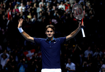 LONDON, ENGLAND - NOVEMBER 27:  Roger Federer of Switzerland celebrates winning the men's final singles match against Jo-Wilfried Tsonga of France during the Barclays ATP World Tour Finals at the O2 Arena on November 27, 2011 in London, England.  (Photo b