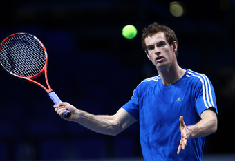 LONDON, ENGLAND - NOVEMBER 18:  Andy Murray of Great Britain plays a volley in a practice session during previews for the ATP World Tour Finals Tennis  at the O2 Arena on November 18, 2011 in London, England.  (Photo by Julian Finney/Getty Images for ATP)