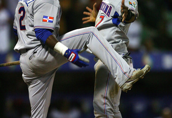 SAN JUAN, PUERTO RICO - MARCH 10:  Jose Reyes #7 and Hanley Ramirez #2 of the Dominican Republic celebrate Reyes scoring a run in the eleventh inning, breaking a 0-0 tie against the Netherlands during the 2009 World Baseball Classic Pool D match at Hiram