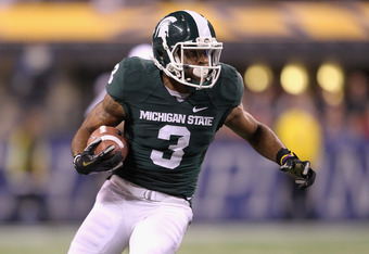 INDIANAPOLIS, IN - DECEMBER 03:  B.J. Cunningham #3 of the Michigan State Spartan runs for yards after the catch against the Wisconsin Badgers during the second half of the Big 10 Conference Championship Game at Lucas Oil Stadium on December 3, 2011 in In