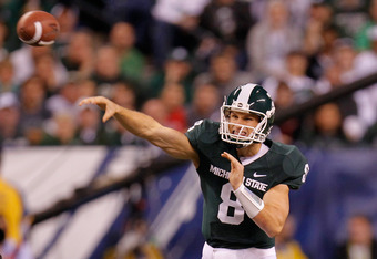 INDIANAPOLIS, IN - DECEMBER 03:  Kirk Cousins #8 of the Michigan State Spartans throws a pass in the first half against the Wisconsin Badgers during the Big 10 Conference Championship Game at Lucas Oil Stadium on December 3, 2011 in Indianapolis, Indiana.