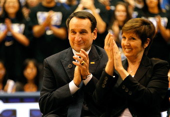 DURHAM, NC - NOVEMBER 18:  Head coach Mike Krzyzewski of the Duke Blue Devils sits with his wife Micki as he is acknowledged for breaking the record for wins in NCAA men's basketball at Cameron Indoor Stadium on November 18, 2011 in Durham, North Carolina