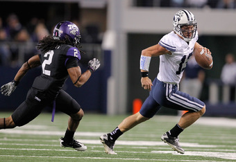 ARLINGTON, TX - OCTOBER 28:  Riley Nelson #13 of the BYU Cougars runs against Jason Verrett #2 of the TCU Horned Frogs at Cowboys Stadium on October 28, 2011 in Arlington, Texas. The TCU Horned Frogs defeated the BYU Cougars 38-28.  (Photo by Sarah Glenn/