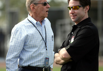 PORT ST. LUCIE, FL - FEBRUARY 17: Owner Fred Wilpon (L) and his son Jeff Wilpon of the New York Mets chat during spring training at Tradition Field on February 17, 2011 in Port St. Lucie, Florida.  (Photo by Marc Serota/Getty Images)