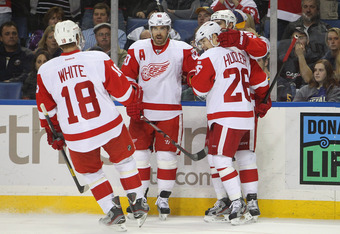 BUFFALO, NY - DECEMBER 4:  Valtteri Filppula #51 of the Detroit Red Wings celebrates his goal with Ian White #18, Henrik Zetterberg #40 and Jiri Hudler #26 during a NHL game against the Buffalo Sabres at First Niagara Center on December 2, 2011 in Buffalo