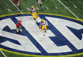 ATLANTA, GA - DECEMBER 3: Tyrann Mathieu #7 of the LSU Tigers returns a punt against the Georgia Bulldogs during the SEC Championship Game at the Georgia Dome on December 3, 2011 in Atlanta, Georgia. (Photo by Scott Cunningham/Getty Images)