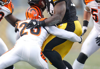 PITTSBURGH, PA - DECEMBER 04:  Rashard Mendenhall #34 of the Pittsburgh Steelers tries to get around the tackle of Kelly Jennings #23 of the Cincinnati Bengals at Heinz Field on December 4, 2011 in Pittsburgh, Pennsylvania. Pittsburgh won the game 35-7. (