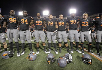 STILLWATER, OK - NOVEMBER 5:  Members of the Oklahoma State Cowboys sing the school song after the game against the Kansas State Wildcats on November 5, 2011 at Boone Pickens Stadium in Stillwater, Oklahoma.  Oklahoma State defeated Kansas State 52-45.  (