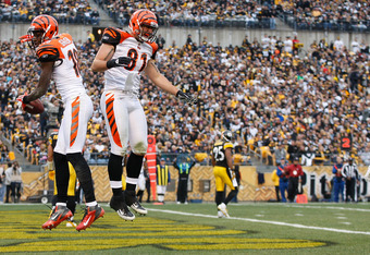 PITTSBURGH, PA - DECEMBER 04:  A.J. Green #18 celebrates with teammate Colin Cochart #81 of the Cincinnati Bengals after Green scored a touchdown against the Pittsburgh Steelers during the game on December 4, 2011 at Heinz Field in Pittsburgh, Pennsylvani