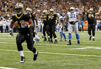 NEW ORLEANS, LA - DECEMBER 04:  Running back Darren Sproles #43 of the New Orleans Saints scores a touchdown against the Detroit Lions in the fourth quarter at Mercedes-Benz Superdome on December 4, 2011 in New Orleans, Louisiana.  (Photo by Chris Graythe