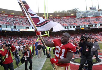 SAN FRANCISCO, CA - DECEMBER 04:  Frank Gore #21 of the San Francisco 49ers celebrates after they beat the St. Louis Rams at Candlestick Park on December 4, 2011 in San Francisco, California.  (Photo by Ezra Shaw/Getty Images)