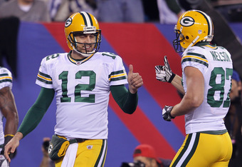 EAST RUTHERFORD, NJ - DECEMBER 04:  Aaron Rodgers #12 and Jordy Nelson #87 of the Green Bay Packers react in the first quarter against the New York Giants at MetLife Stadium on December 4, 2011 in East Rutherford, New Jersey.  (Photo by Nick Laham/Getty I