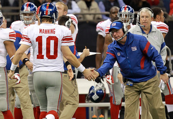 NEW ORLEANS, LA - NOVEMBER 28:  Head coach Tom Coughlin celebrates a touchdown with  Eli Manning #10 of the New York Giants during play against the New Orleans Saints at Mercedes-Benz Superdome on November 28, 2011 in New Orleans, Louisiana.  (Photo by Ro