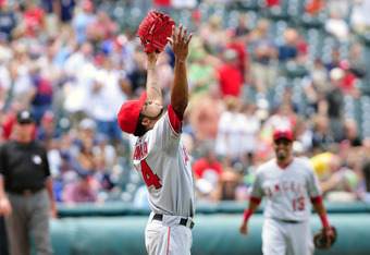 CLEVELAND, OH - JULY 27:  Starting pitcher Ervin Santana #54 of the Los Angeles Angels throws up his arms in celebration after finishing a no-hitter against the Cleveland Indians on July 27, 2011 at Progressive Field in Cleveland, Ohio. The Angels defeate