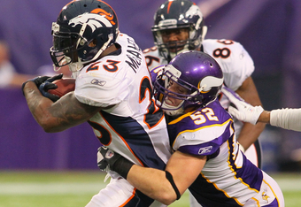 MINNEAPOLIS, MN - DECEMBER 4:  Chad Greenway #52 of the Minnesota Vikings tackles Willis McGahee #23 of the Denver Broncos at the Hubert H. Humphrey Metrodome on December 4, 2011 in Minneapolis, Minnesota.  (Photo by Adam Bettcher /Getty Images)