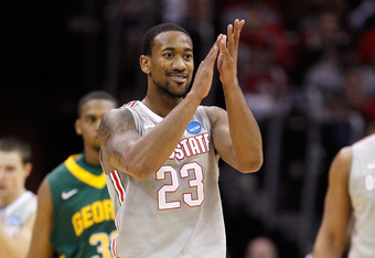 CLEVELAND, OH - MARCH 20: David Lighty #23 of the Ohio State Buckeyes claps after a play in the first half against the George Mason Patriots during the third of the 2011 NCAA men's basketball tournament at Quicken Loans Arena on March 20, 2011 in Clevelan