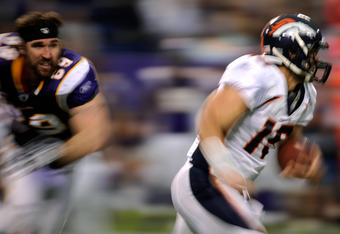 MINNEAPOLIS, MN - DECEMBER 4: Tim Tebow #15 of the Denver Broncos scrambles with the ball as Jared Allen #69 of the Minnesota Vikings gives chase in the fourth quarter on December 4, 2011 at Mall of America Field at the Hubert H. Humphrey Metrodome in Min