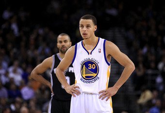 OAKLAND, CA - JANUARY 24:  Stephen Curry #30 of the Golden State Warriors stands at midcourt during their game against the San Antonio Spurs at Oracle Arena on January 24, 2011 in Oakland, California.  NOTE TO USER: User expressly acknowledges and agrees