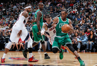 ATLANTA, GA - APRIL 01:  Rajon Rondo #9 of the Boston Celtics against Kirk Hinrich #6 of the Atlanta Hawks at Philips Arena on April 1, 2011 in Atlanta, Georgia.  NOTE TO USER: User expressly acknowledges and agrees that, by downloading and/or using this