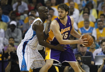 NEW ORLEANS, LA - APRIL 24:  Emeka Okafor #50 of the New Orleans Hornets guards Pau Gasol #16 of the Los Angeles Lakers in Game Four of the Western Conference Quarterfinals in the 2011 NBA Playoffs at New Orleans Arena on April 24, 2011 in New Orleans, Lo