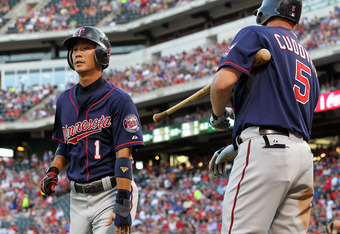ARLINGTON, TX - JULY 26:  Tsuyoshi Nishioka #1 of the Minnesota Twins celebrates a run with Michael Cuddyer #5 during play against the Texas Rangers at Rangers Ballpark in Arlington on July 26, 2011 in Arlington, Texas.  (Photo by Ronald Martinez/Getty Im