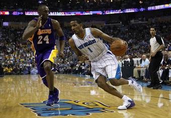 NEW ORLEANS, LA - APRIL 24:  Trevor Ariza #1 of the New Orleans Hornets drives around Kobe Bryant #24 of the Los Angeles Lakers in Game Four of the Western Conference Quarterfinals in the 2011 NBA Playoffs at New Orleans Arena on April 24, 2011 in New Orl