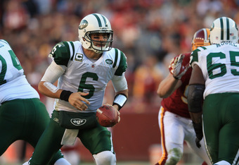 LANDOVER, MD - DECEMBER 04:  Mark Sanchez #6 of the New York Jets hands the ball off against the Washington Redskins at FedExField on December 4, 2011 in Landover, Maryland.  (Photo by Rob Carr/Getty Images)