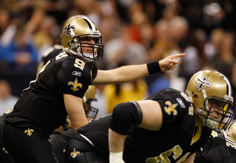 NEW ORLEANS, LA - DECEMBER 04:  Quarterback Drew Brees #9 of the New Orleans Saints signals during the first quarter against the Detroit Lions at Mercedes-Benz Superdome on December 4, 2011 in New Orleans, Louisiana.  (Photo by Chris Graythen/Getty Images
