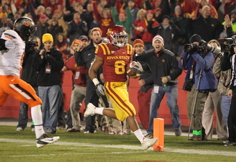 AMES, IA - NOVEMBER 18:  James White #8 of the Iowa State Cyclones scores the game-tying touchdown against the Oklahoma State Cowboys in the fourth quarter at Jack Trice Stadium November 18, 2011 in Ames, Iowa.  (Photo by Reese Strickland/Getty Images)