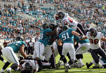 JACKSONVILLE, FL - NOVEMBER 27:  Arian Foster #23 of the Houston Texans dives for a touchdown during the game against the Jacksonville Jaguars  at EverBank Field on November 27, 2011 in Jacksonville, Florida.  (Photo by Sam Greenwood/Getty Images)