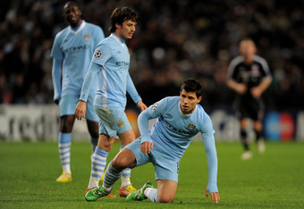 MANCHESTER, ENGLAND - DECEMBER 07:  Sergio Aguero (R) and David Silva of Manchester City look on during the UEFA Champions League Group A match between Manchester City and FC Bayern Muenchen at the Etihad Stadium on December 7, 2011 in Manchester, England