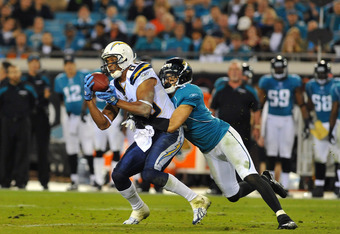 JACKSONVILLE, FL - DECEMBER 5:  Wide receiver Malcolm Floyd #80 of the San Diego Chargers grabs a midfield pass against the Jacksonville Jaguars in a Monday Night Football game December 5, 2011 at EverBank Field in Jacksonville, Florida.  (Photo by Al Mes