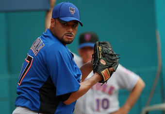 MIAMI GARDENS, FL - JULY 24:  Johan Santana #57 of the New York Mets pitches in the bullpen as Manager Terry Collins #10 looks on during a throwing session before a game against the Florida Marlins at Sun Life Stadium on July 24, 2011 in Miami Gardens, Fl